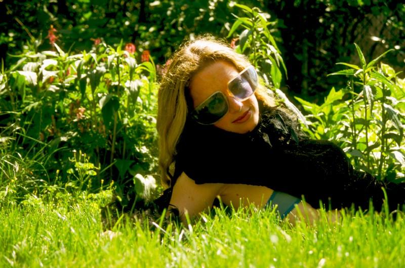 Dara wearing Blue Sunglasses, © Margaret Schnipper, photographer