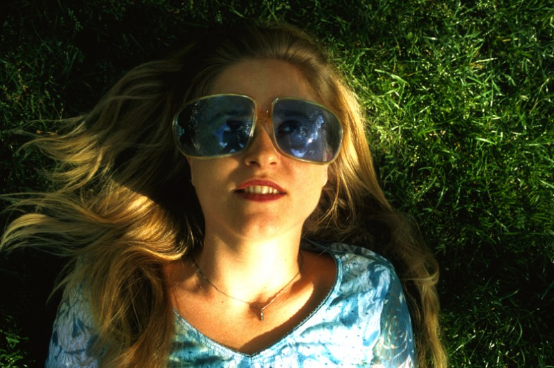Mary wearing Blue Sunglasses, © Margaret Schnipper, photographer